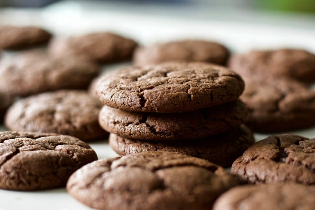Chewy Chocolate Cookies batch with a stack of cookies in the middle of a cookie pile.