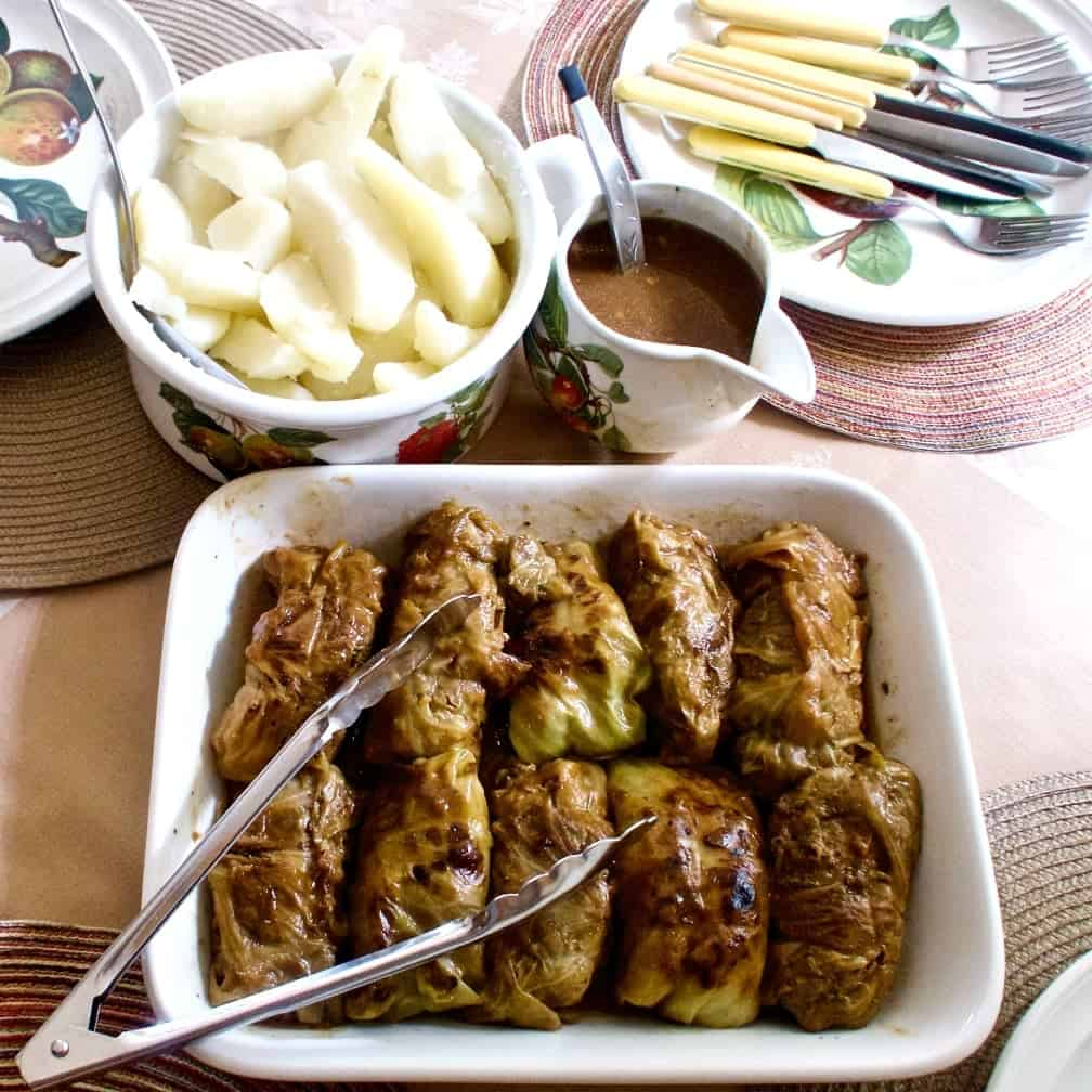 German Cabbage Rolls dinner with Gravy and potatoes ready to serve.