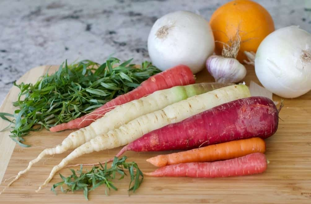 Ingredients for Carrot Tarragon Soup. Rainbow carrots, white onions, fresh garlic, fresh tarragon and fresh oranges