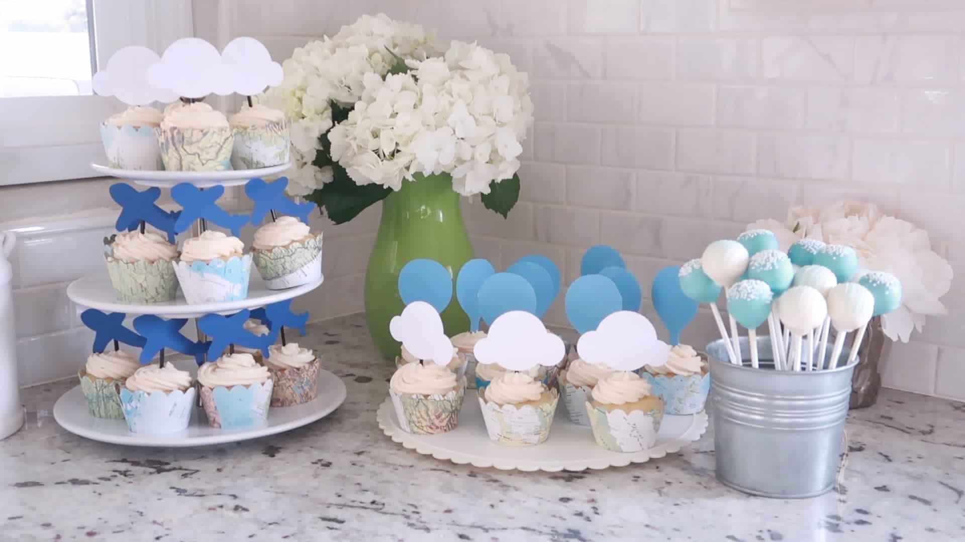 Baby Shower Cupcakes on platters with white hydrangeas and a can of cake pops
