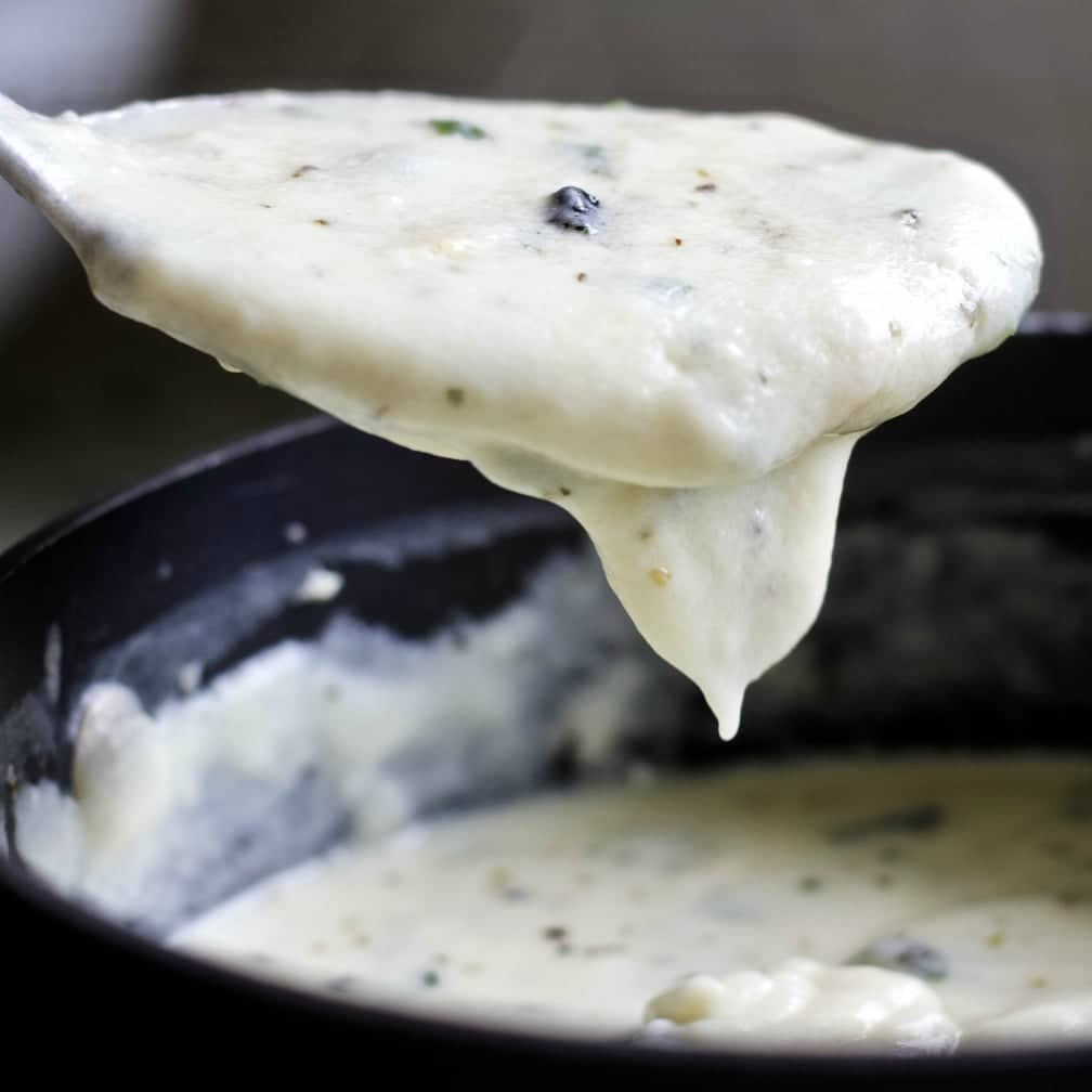 homemade alfredo sauce with Italian herbs, fresh basil and parmesan cheese
