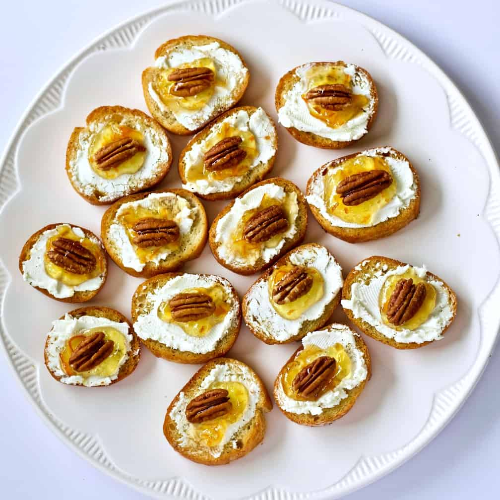 a party tray loaded with Crostini appetizers