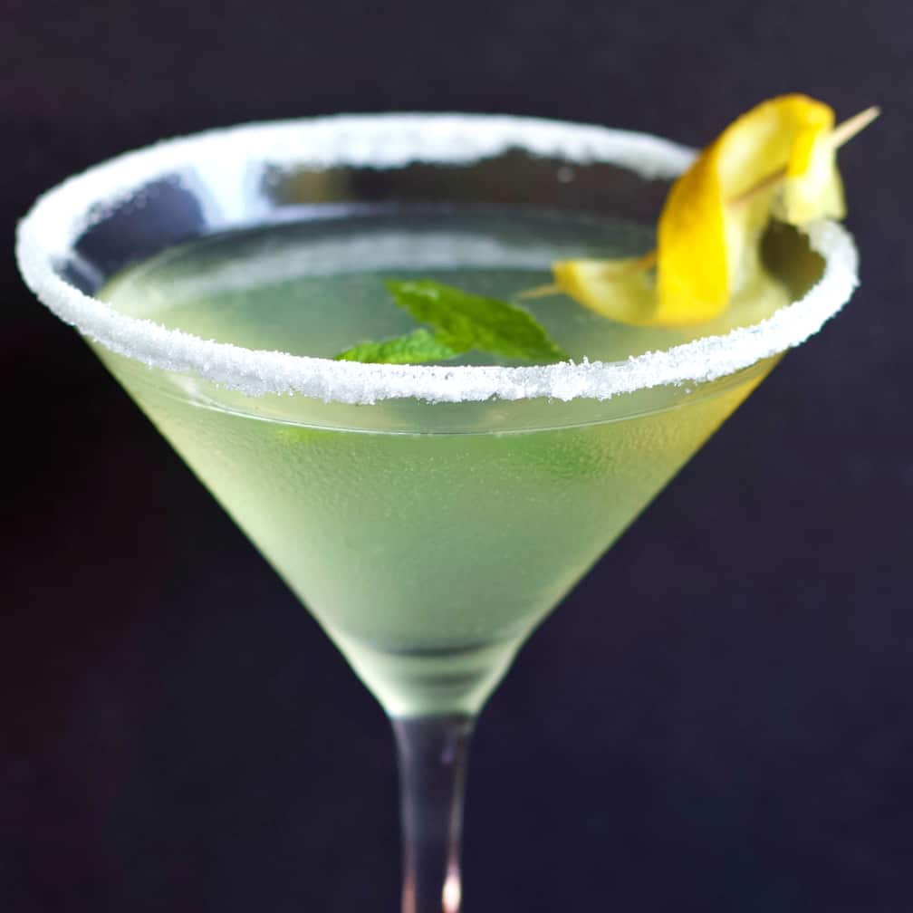 Limoncello Lemon Drop Martini with mint leaves and a lemon twist