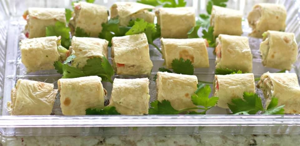 Tortilla pinwheels on a tray side shot.