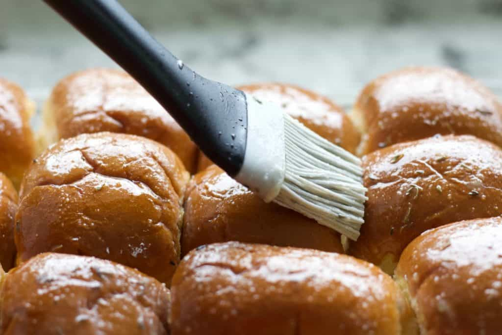Basting The Sliders With Herbed Butter