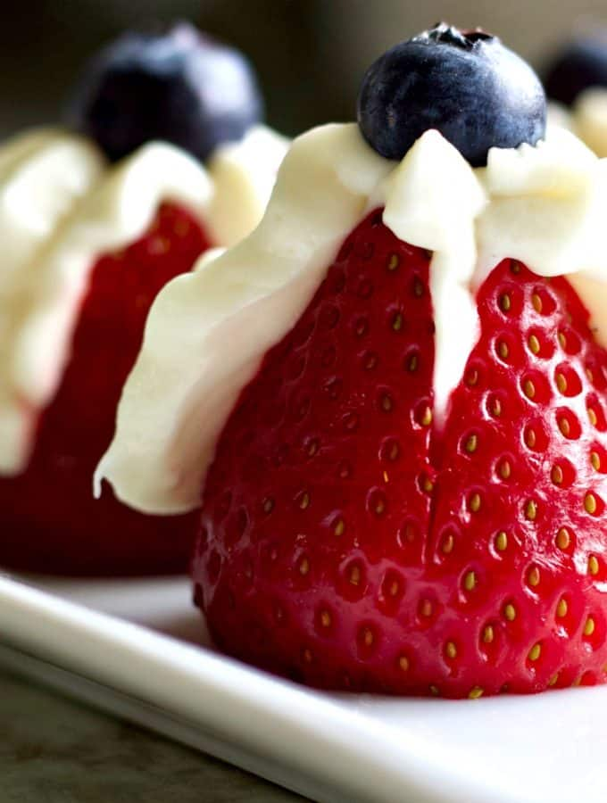 strawberry filled with sweet cream cheese and a blueberry topper.