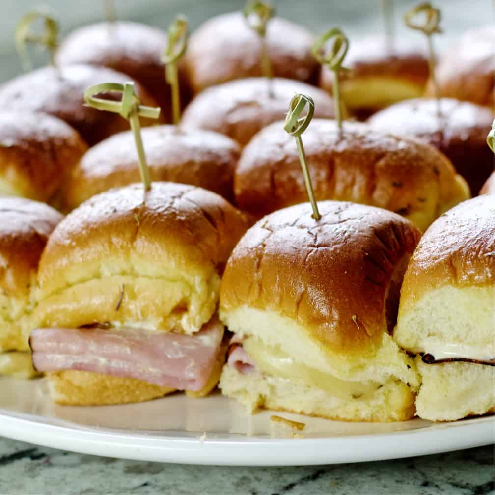 baked ham and cheese sliders showing the ham and melted cheese.