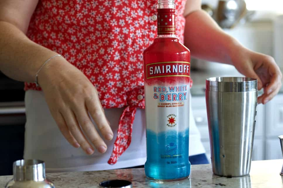 ready to measure and pour smirnoff red white and berry into the cocktail shaker