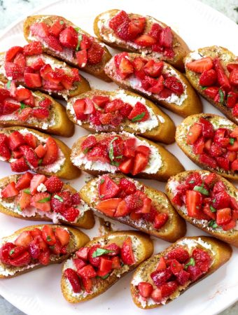 a tray full of strawberry basil bruschetta