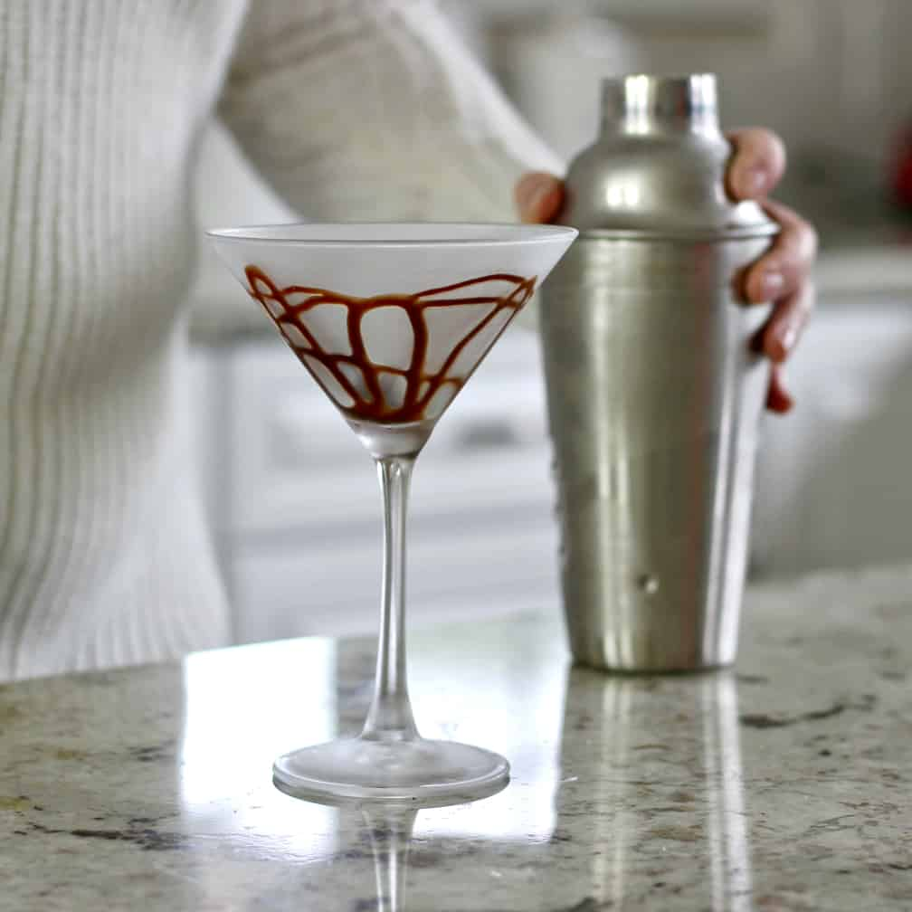 martini glass with chocolate syrup swirled around inside it.
