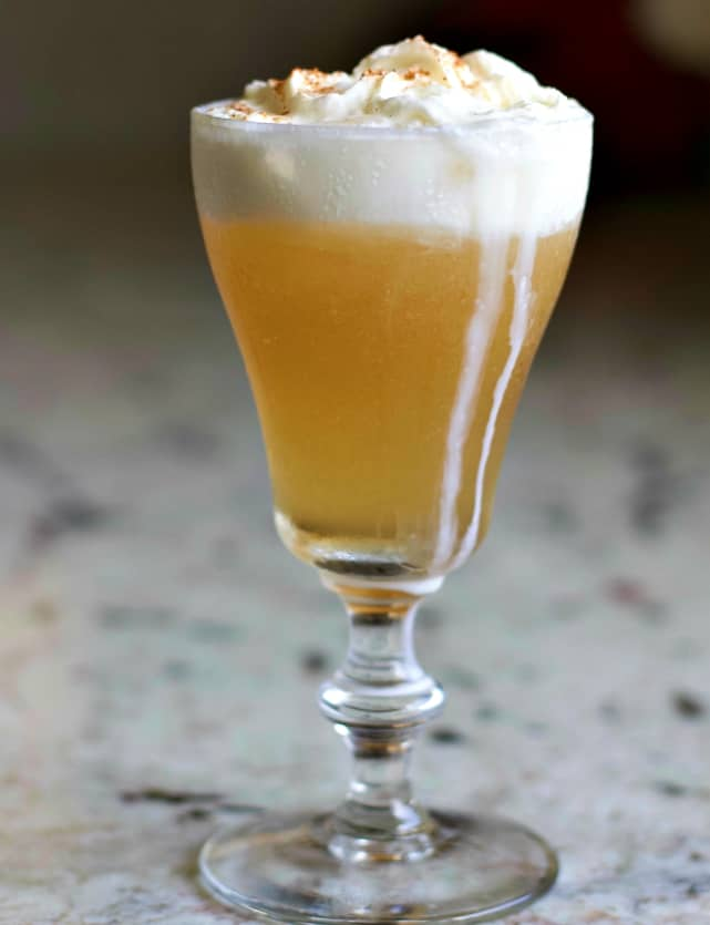 Caramel Vanilla Cream Soda Cocktail with whipped cream running down the sides