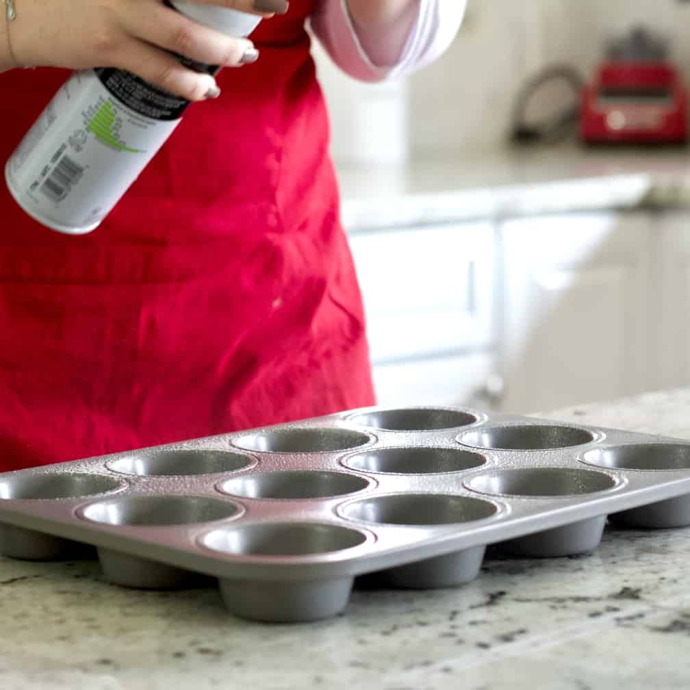 Spraying the muffin tin-banana nut muffin recipe