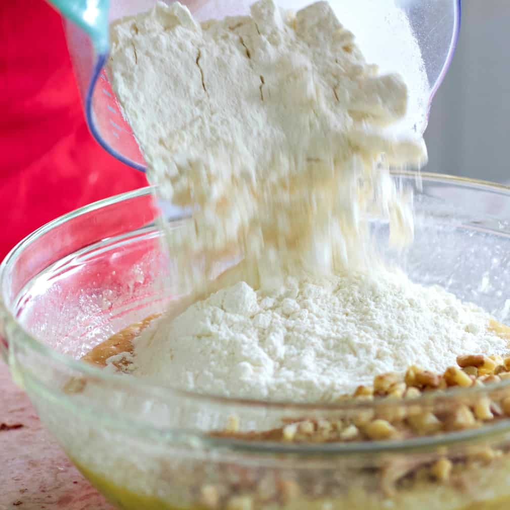 Add the dry ingredients and the walnuts for banana nut muffin recipe
