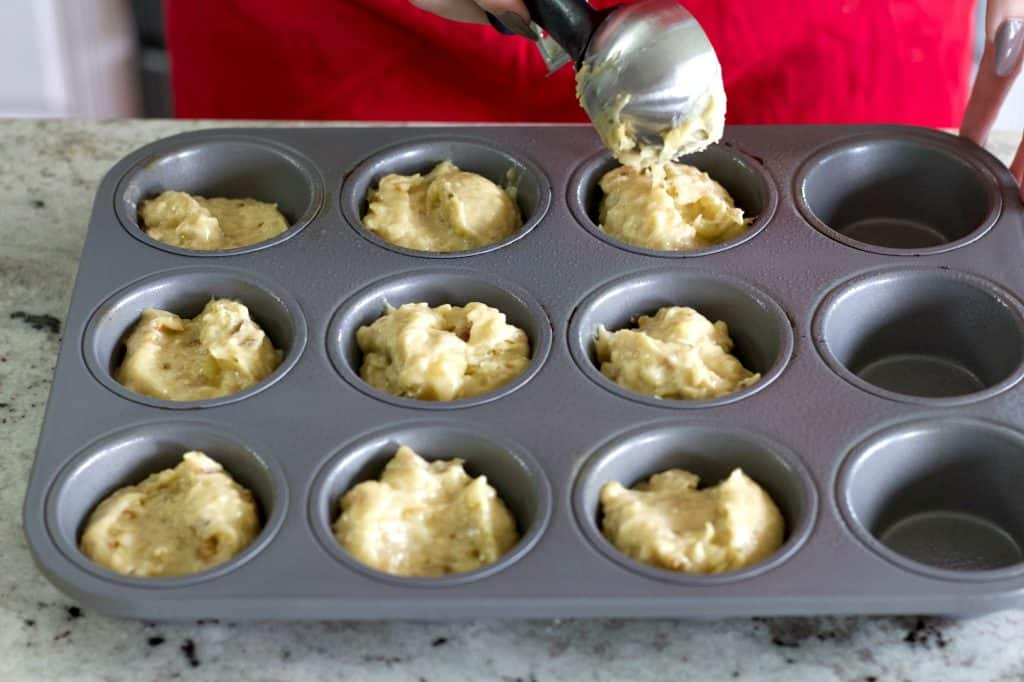Filling the muffin tin with batter