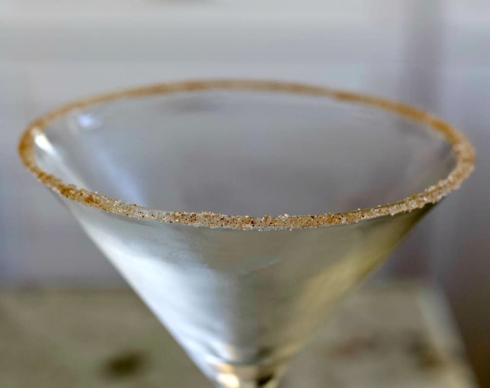 Rimmed martini glass with sugar and pumpkin pie spice
