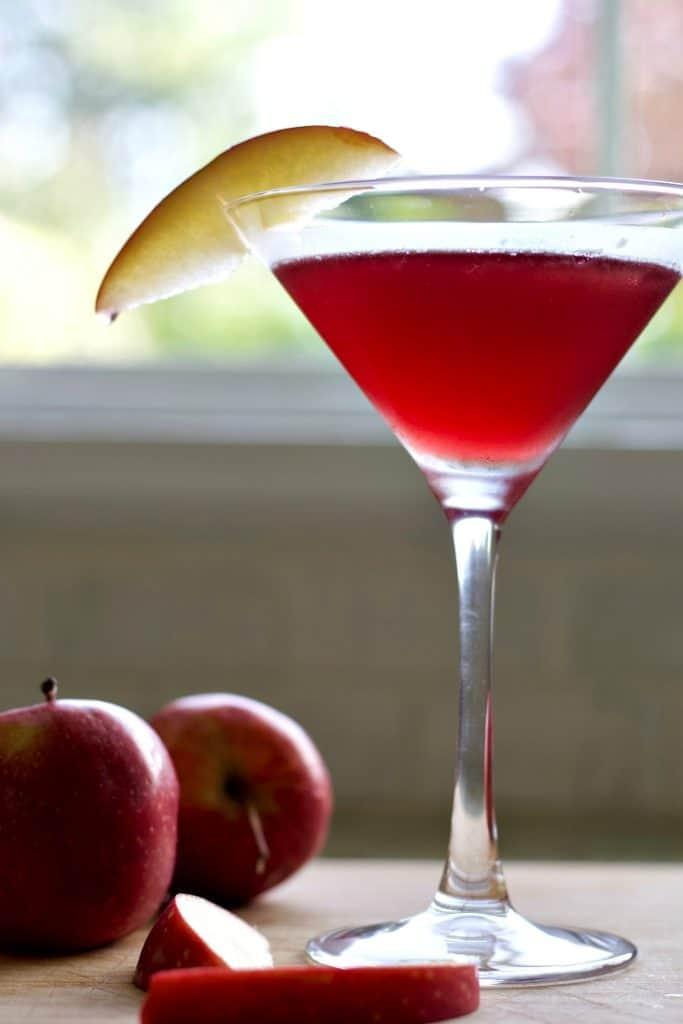 Washington Apple cocktail on a board with apples