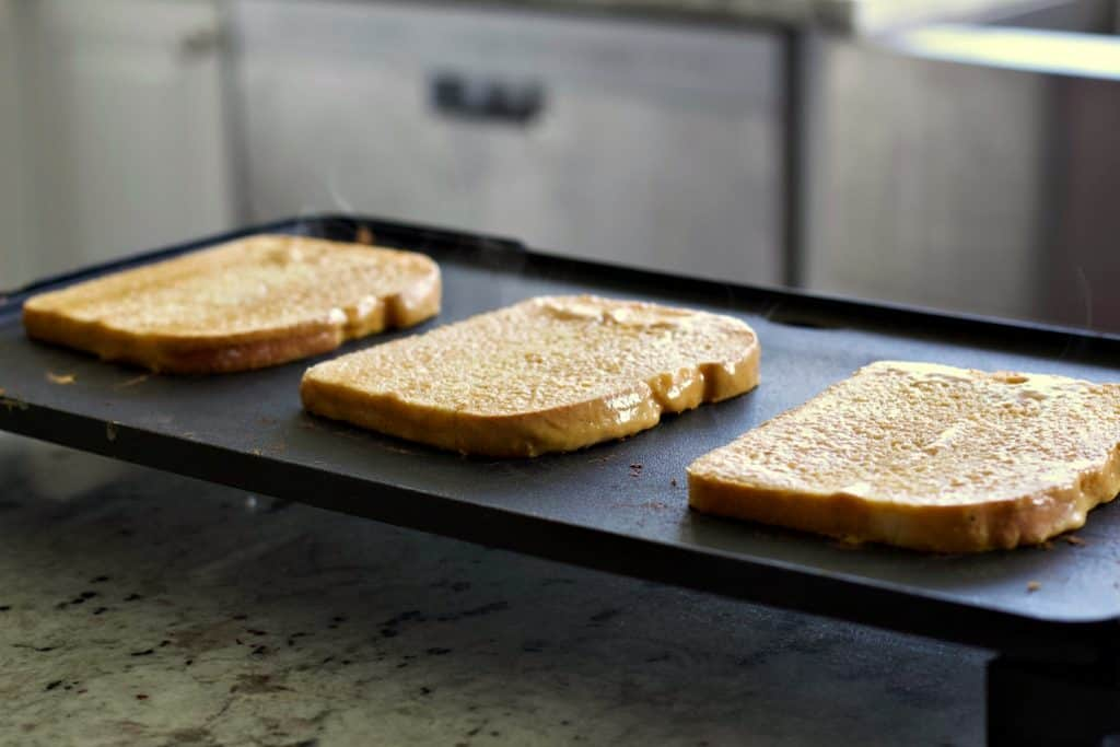 french toast cooking on a griddle