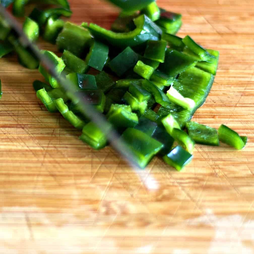 Choppin green pepper on a cutting board