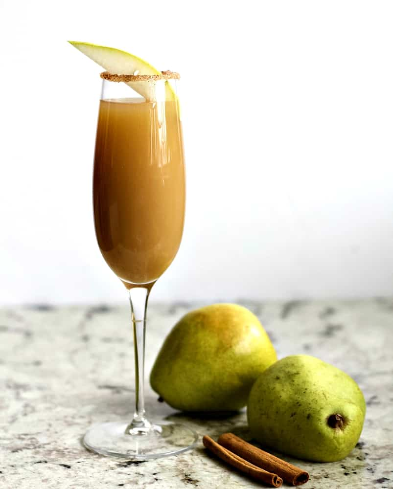 Cinnamon pear cocktail with pears and cinnamon stick