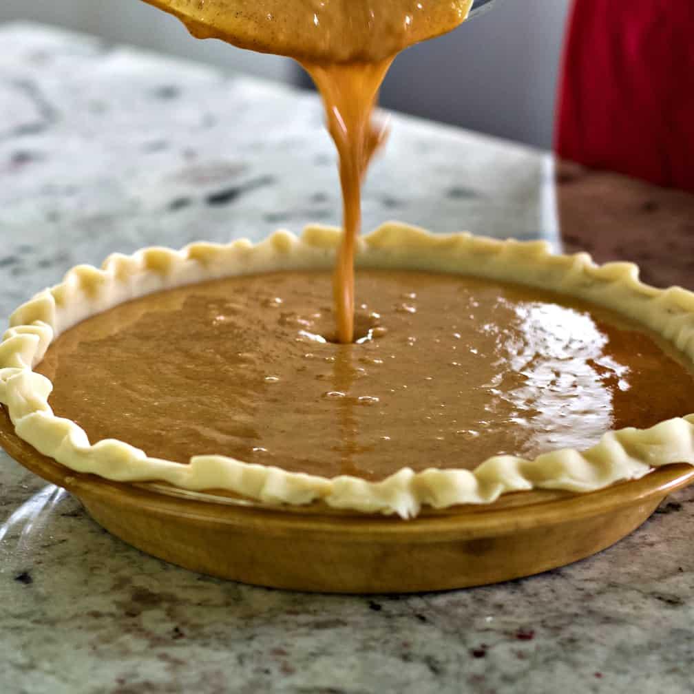Sweet Potato Pumpkin Pie-Pouring Batter In Pie Shell