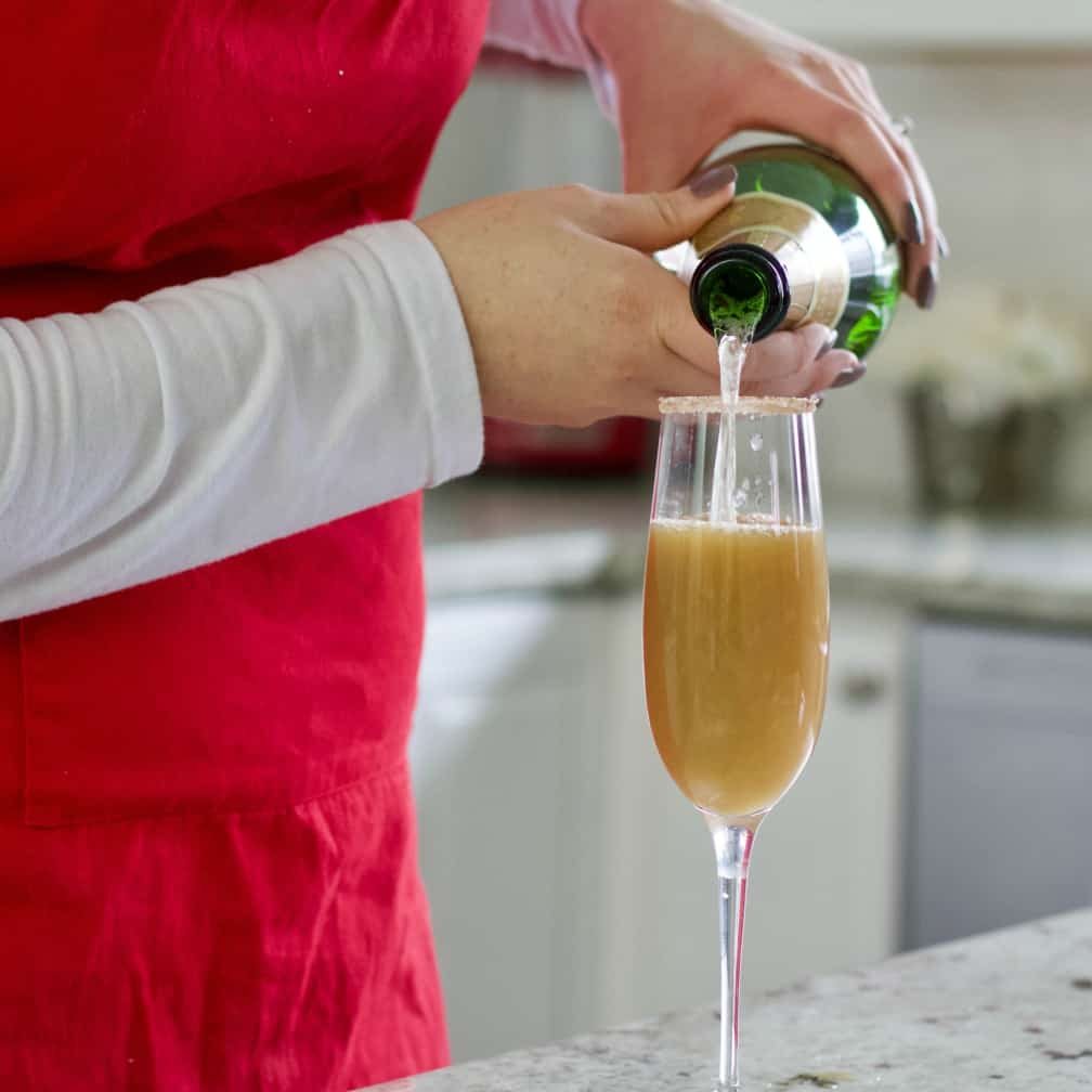 pouring champagne into pear juice