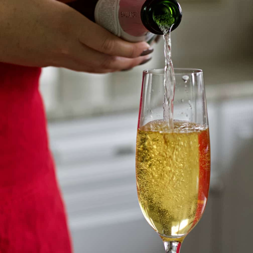 pour in sparkling wine