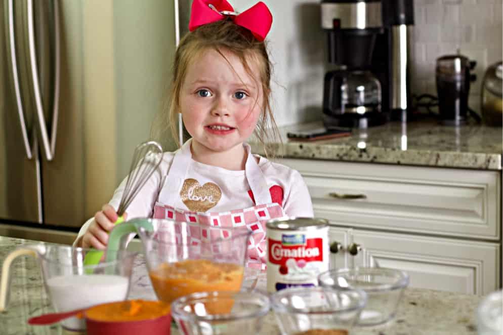 Ellie with sweet potato pumpkin pie ingredients