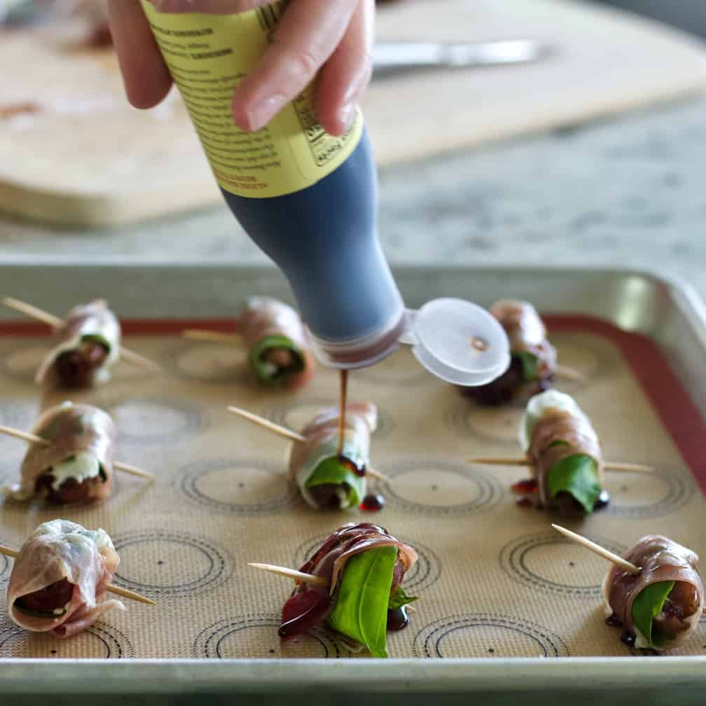 pour balsamic onto stuffed dates