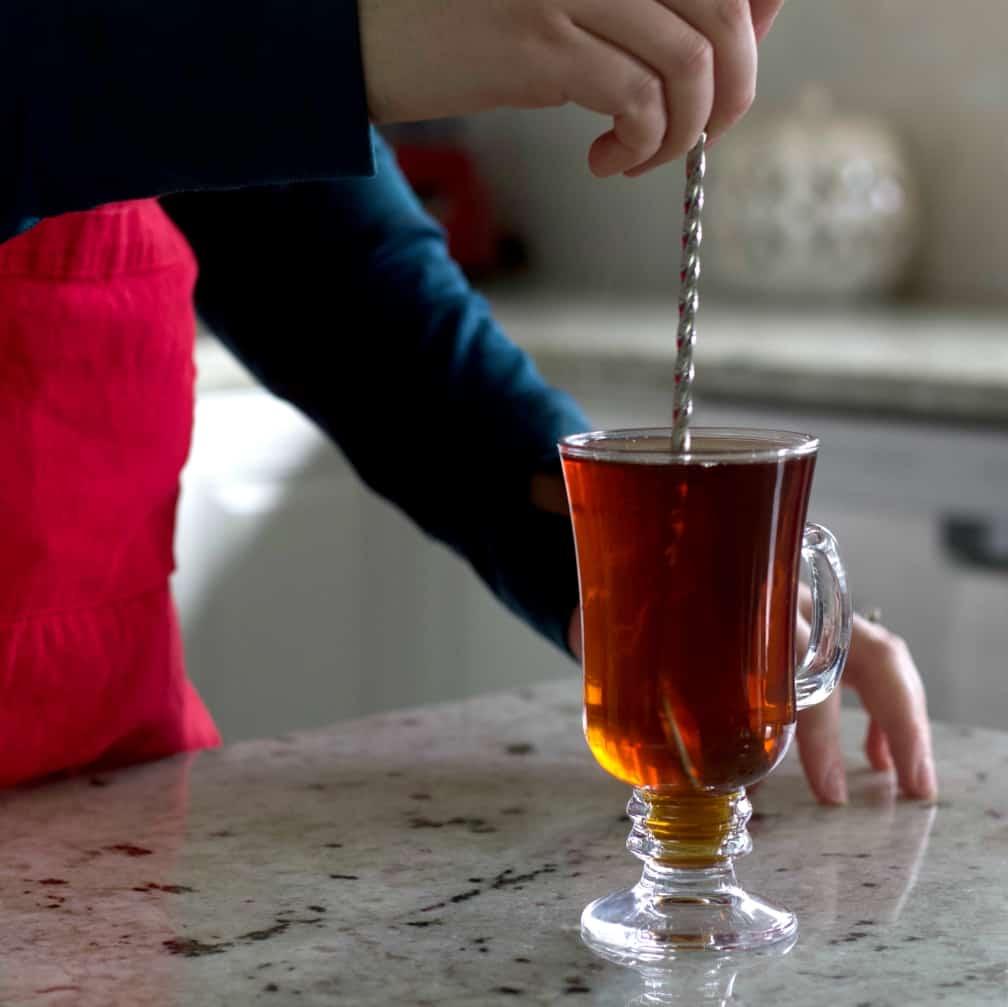 stirring the cafe amaretto