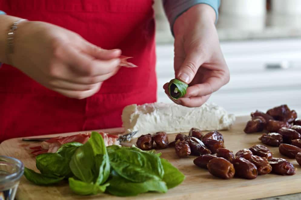 wrap prosciutto around the fresh basil