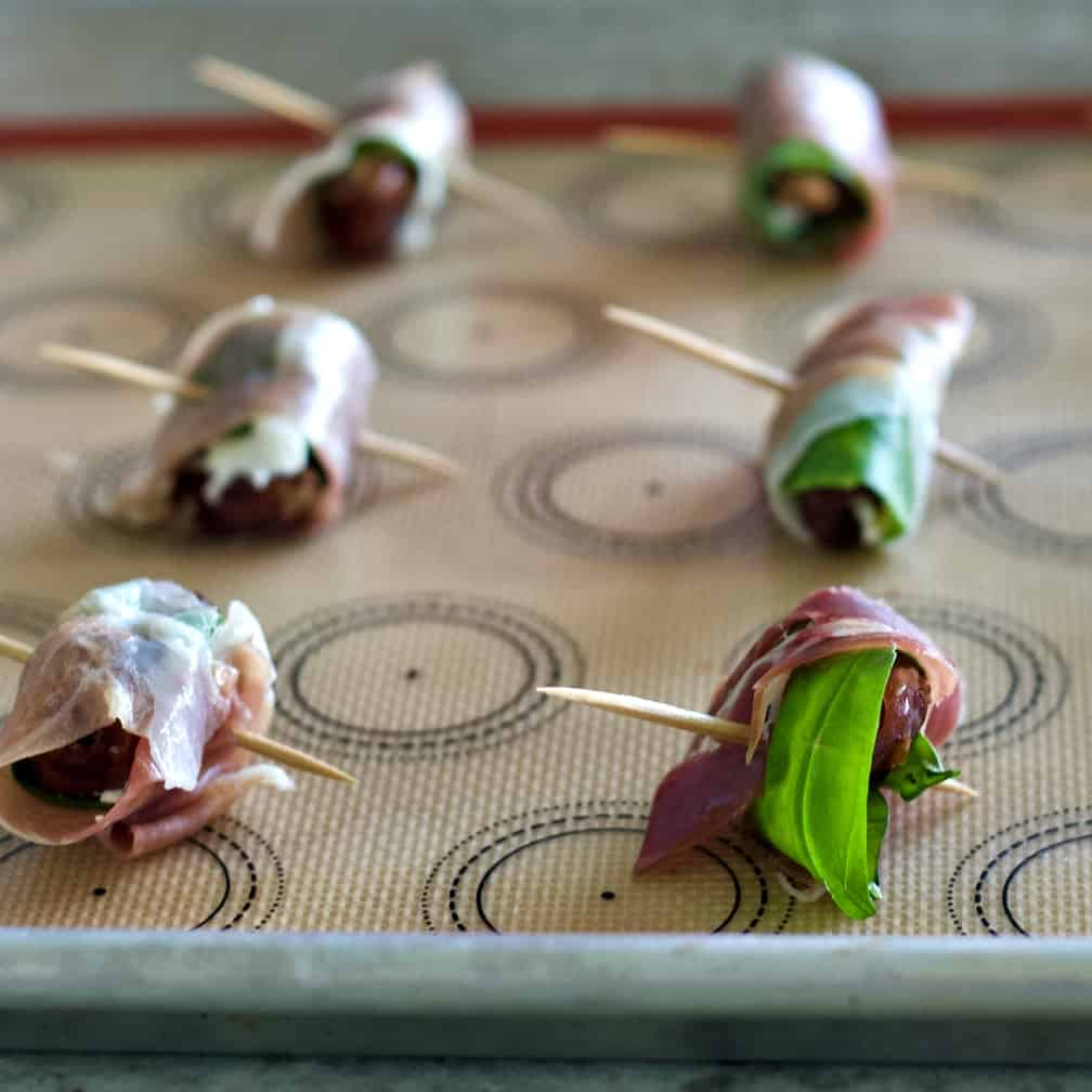 lay wrapped dates on baking tray