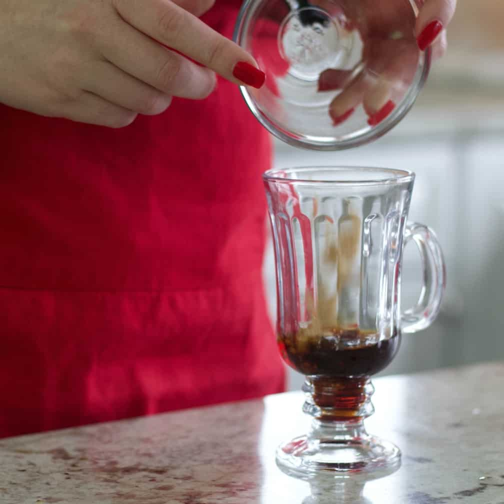 Pouring brown sugar into mug-Mexican coffee