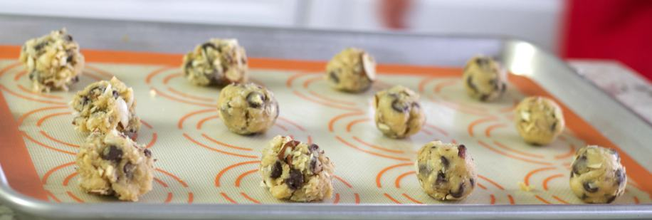 almond joy cookie dough balls on a baking sheet