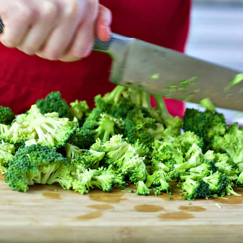 chopping broccoli for broccoli soup