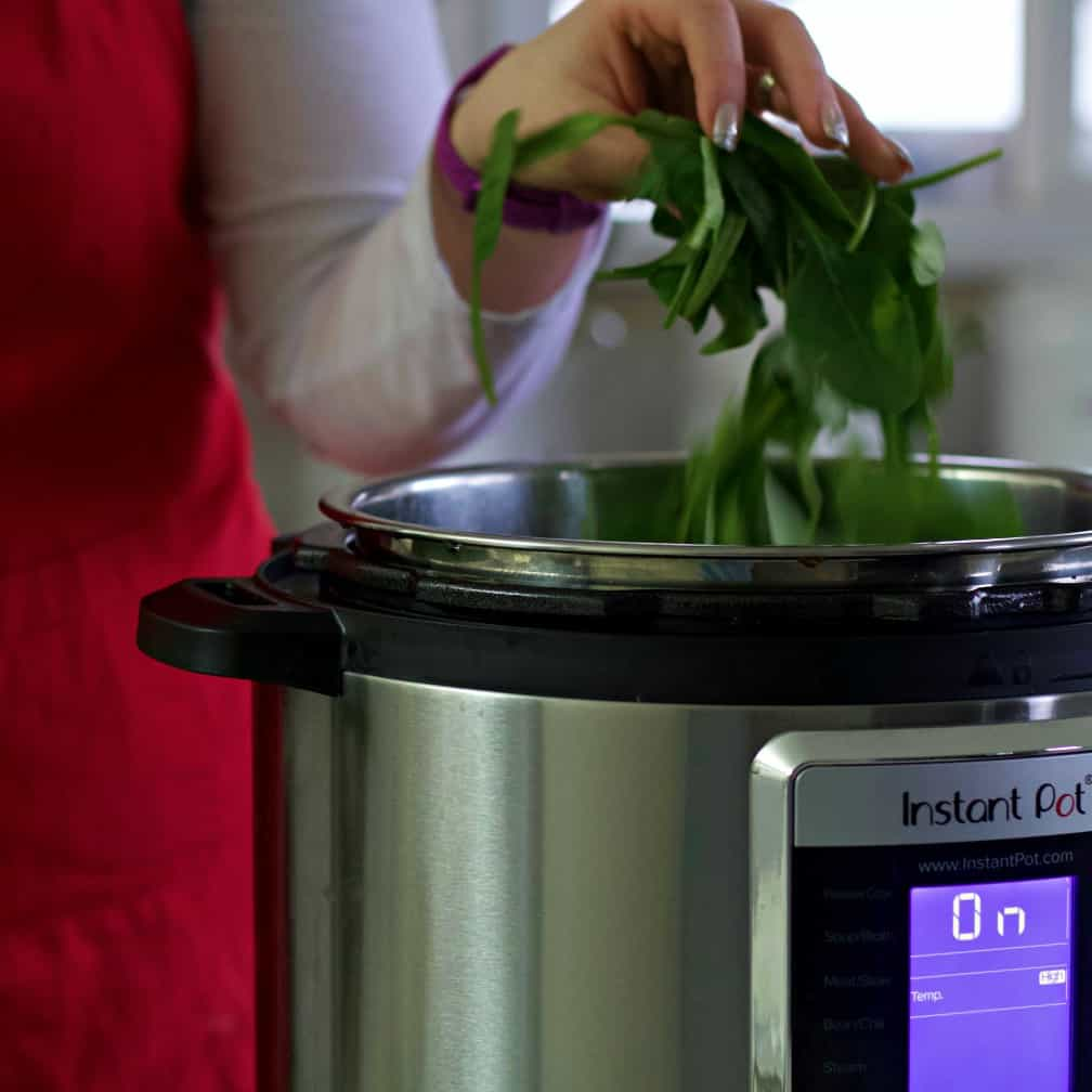 Adding fresh spinach into the instant pot