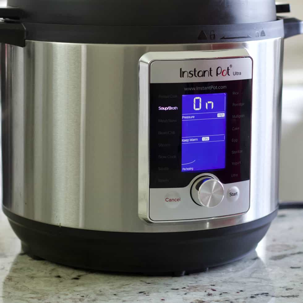 instant pot pot with soup function lighted.