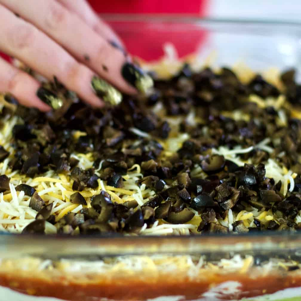 spread olives over cheese layer.