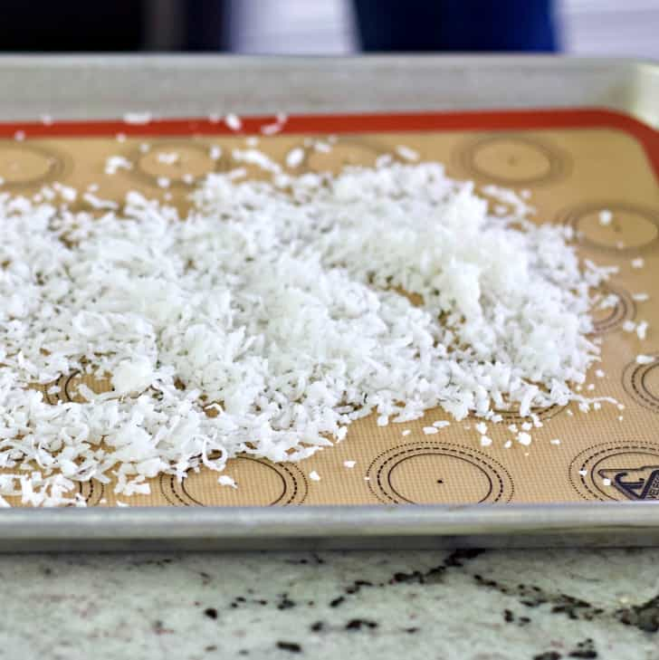 coconut flakes on a baking sheet