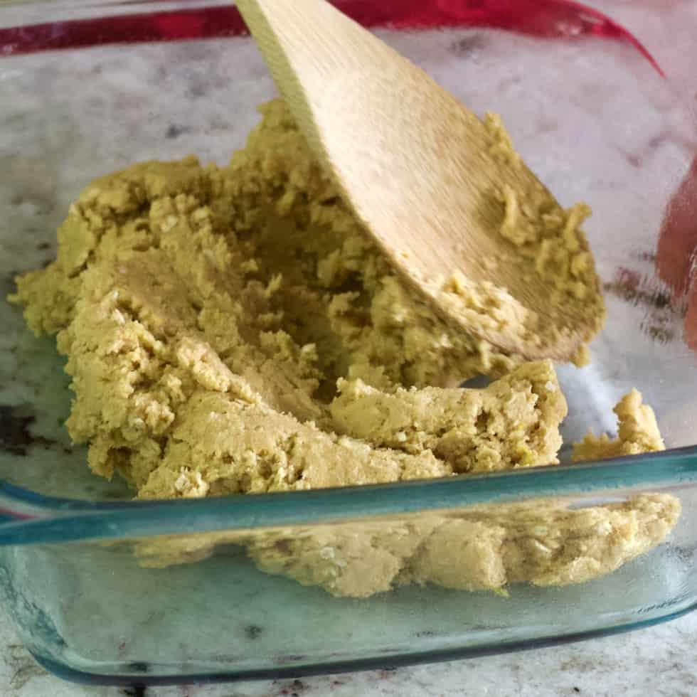 press lemon cookie dough into oiled pan.