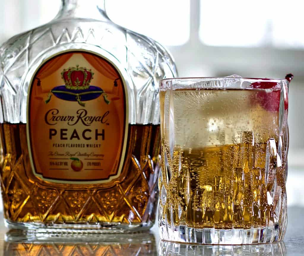 Crown royal peaches and cream cocktail with crown royal peach whiskey bottle