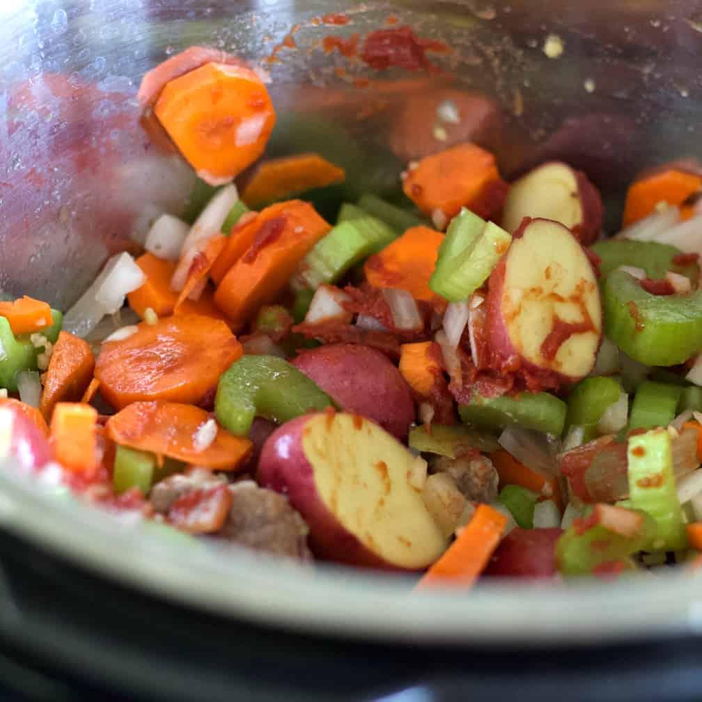 stir in tomato paste