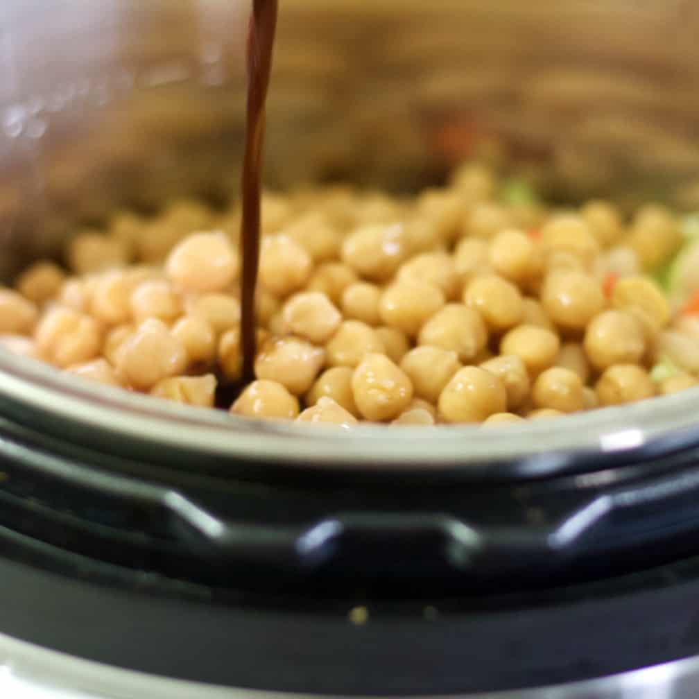 pouring Worcestershire Sauce into beans