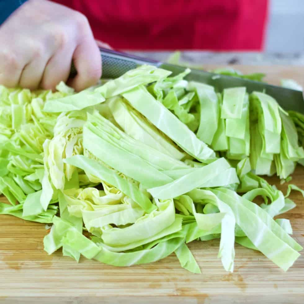 chopping green cabbage for cabbage beef stew