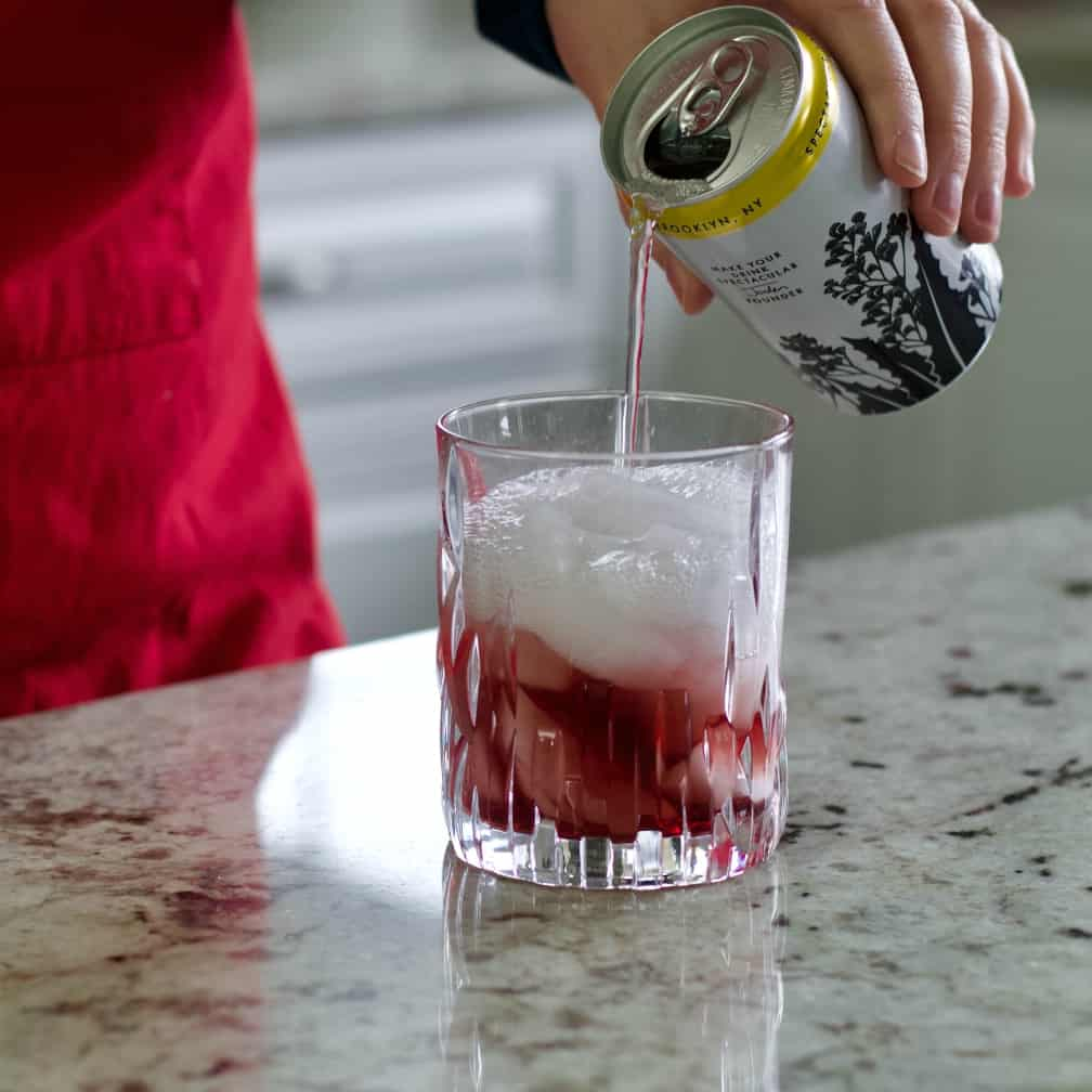 pouring tonic water in cocktail