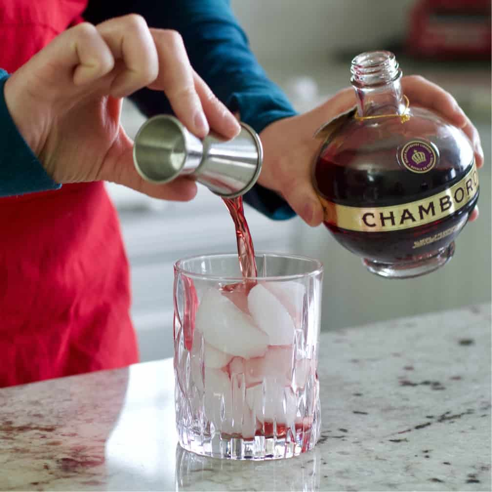 pouring chambord over ice