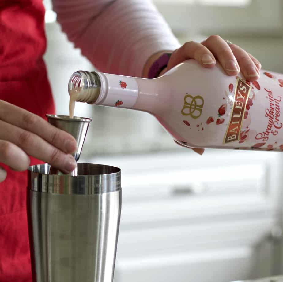 measuring Baileys Strawberries and cream liqueur