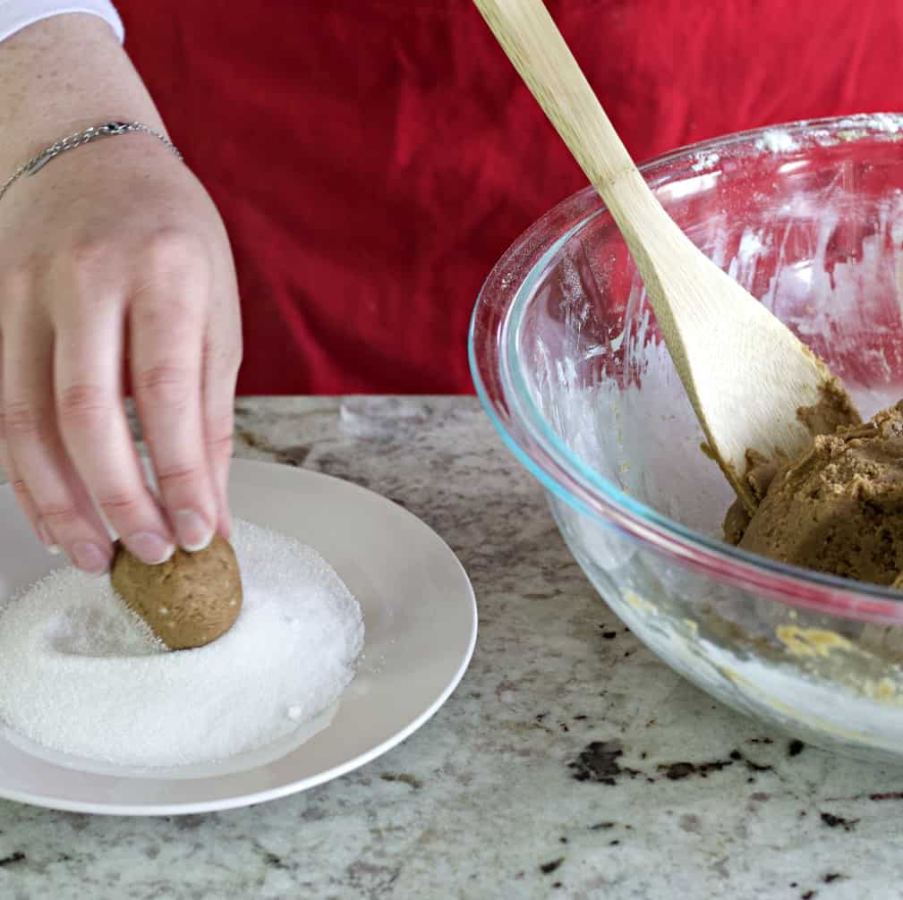 roll molasses cookies in sugar