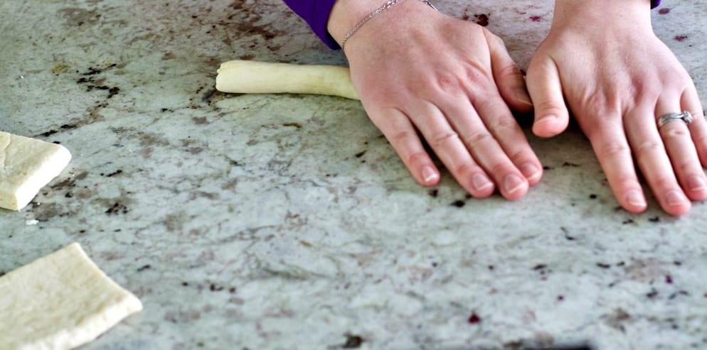 Rolling Pretzel Dough Ropes.