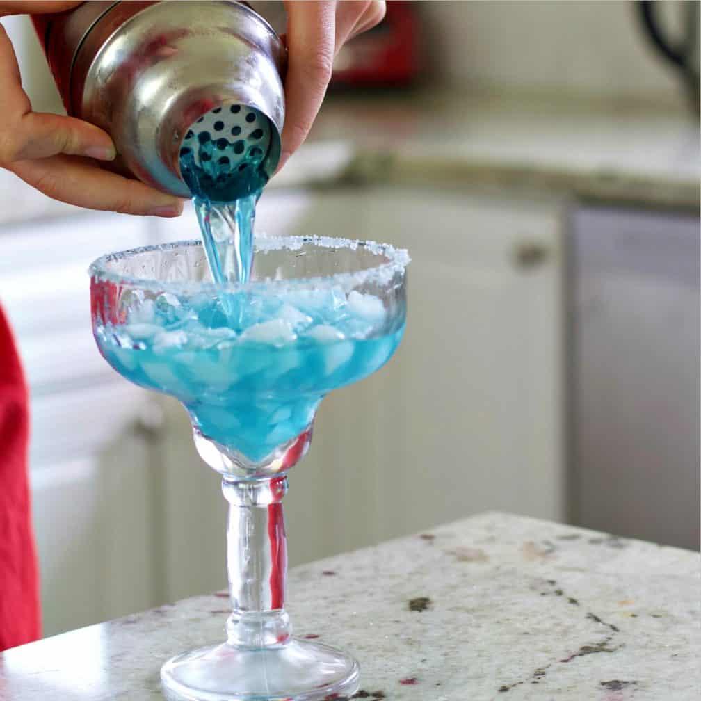 Straining the blue margarita