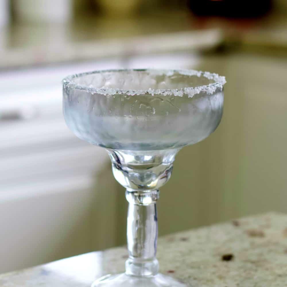 Salt rimmed Margarita glass for blue margarita.